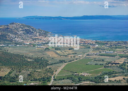 Spain aerial view over the city of Roses on the shore of the Mediterranean sea with olive groves and vineyards fields, - Stock Photo