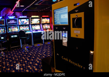 Fruit machines, Fixed Odds Betting Terminals, gambling machines, slot machines in amusement arcade UK - Stock Photo