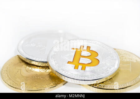 Abstract photo of cryptocyrrency. Some cryptocurrency coins in mans hand. Isolated on white background. - Stock Photo