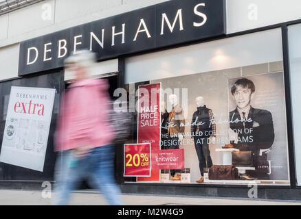 Shoppers walking past Jasper Conran window display in Debenhams store, Middlesbrough. UK - Stock Photo