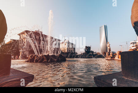 View from a fountane with a modern tower (Lifecity) on the background - Milan - Italy - Stock Photo