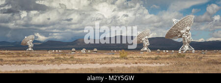 Very Large Array (VLA) Radio Telescopes with pronghorn antelopes in the foreground located at the NRAO Site in Socorro, - Stock Photo