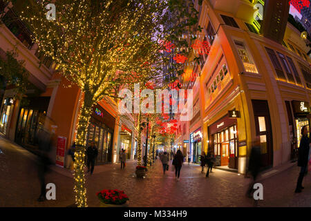 Decorations lit up at night at the Lee Tung Avenue, the new urban renewal development in Hong Kong, China. - Stock Photo