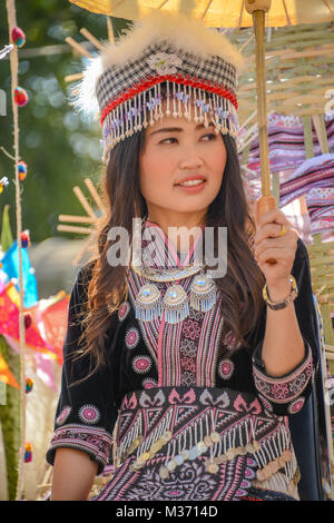 Chiangmai, Thailand - January 25, 2015: Hill tribe girl holding white paper umbrella in parade of 22nd Traditional - Stock Photo