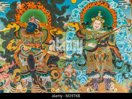 Coorg, India - October 29, 2013: Vivid color of painting of warrior and musicians outside Padmasambhava Vihara at - Stock Photo