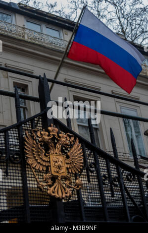 February 10, 2018 - London, UK. 10th February 2018. The Russian flag fliesw above the eagle on the gates of the - Stock Photo