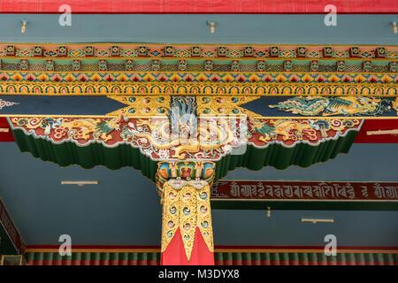 Coorg, India - October 29, 2013: Gold decorated pilar and beams supporting Mandapam at Padmasambhava Vihara at Namdroling - Stock Photo