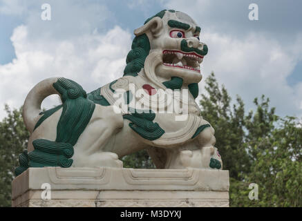 Coorg, India - October 29, 2013: The guardian statue of the mutached snow lion on the step of the Padmasambhanva - Stock Photo