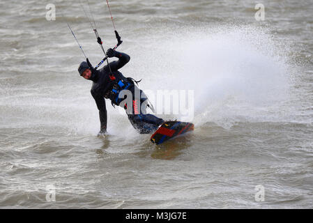Wind surfers took to the Thames Estuary off Thorpe Bay, Southend on Sea, in strong but chill winds - Stock Photo