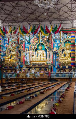 Coorg, India - October 29, 2013: Inside Padmasambhava Vihara of Namdroling Buddhist Monastery. The golden statues - Stock Photo
