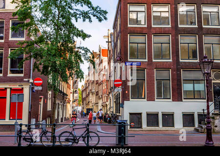 AMSTERDAM, THE NETHERLANDS - JUNE 10, 2014: Beautiful facades of canal buildings in Amsterdam - Stock Photo