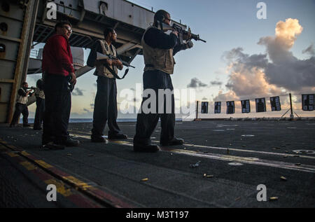 151208-N-EH855-390 ATLANTIC OCEAN (Dec. 8, 2015) Sailors participate in a live-fire exercise aboard aircraft carrier - Stock Photo