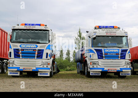 HATTULA, FINLAND - JULY 12, 2014: Two Scania tipper trucks on display at Tawastia Truck Weekend in Hattula, Finland. - Stock Photo
