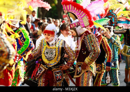 TLAXCALA, MEXICO - FEBRUARY, 08, 2018 Group of mexican dancers with bright mexican folk costumes during the annual - Stock Photo
