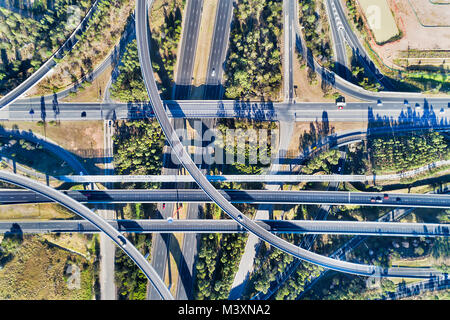 Aerial top down view on massive multi-level interchange on Sydney's Motorway 4 and Motorway 7 on a sunny summer - Stock Photo