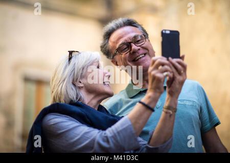 Senior couple on vacation taking a selfie - Stock Photo