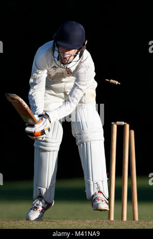 Cricket batsman being bowled out. - Stock Photo