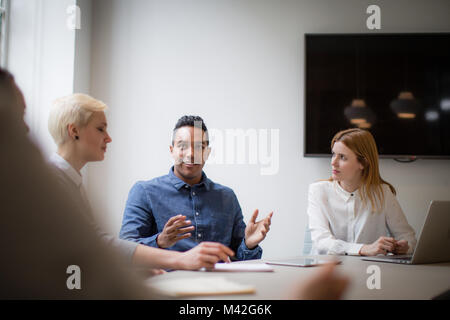 Businessman having an idea in a business meeting - Stock Photo