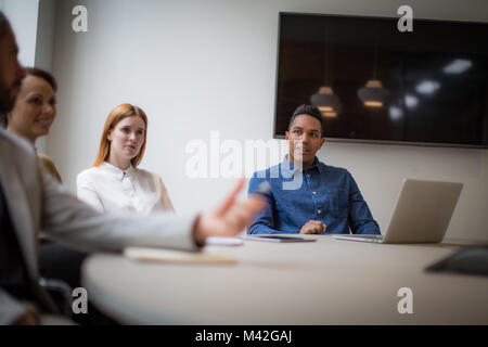 Colleagues having a discussion in a business meeting - Stock Photo