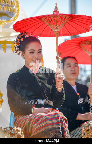 Chiangmai, Thailand - January 25, 2015: Indigenous girl holding red paper umbrella in parade of 22nd Traditional - Stock Photo
