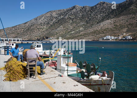 Fishermen repairing fishing nets on quayside, Kamares, Sifnos, Cyclades, Aegean Sea, Greek Islands, Greece, Europe - Stock Photo