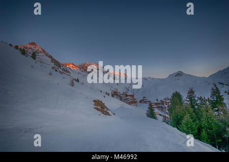 Winter sunset landscape at Belle Plagne ski resort in La Plagne, Savoie, France. Credit: Malcolm Park/Alamy. - Stock Photo