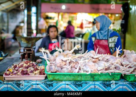 Jimbaran, Bali, 6 September 2013:  Raw chicken sold on Jimbaran market in Bali - Stock Photo