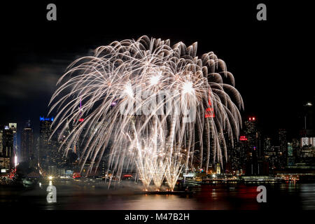 New York, USA. 14th Feb, 2018. Fireworks light up the sky over the Hudson River in the celebrations of the Chinese - Stock Photo