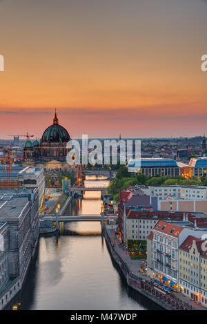 The Spree river in Berlin with the cathedral at sunset - Stock Photo