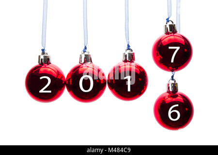 Red christmas balls transition old to new year 2017 - Stock Photo