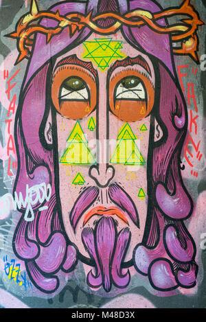 Colorful graffiti on roller shutter in Barcelona - Stock Photo