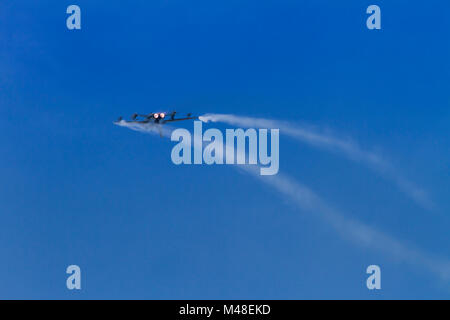 A Royal Air Force Tornado GR4 in a high speed loop with afterburners and vortices - Stock Photo