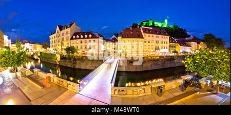 Evening panorama of Ljubljana river, architecture and castle - Stock Photo