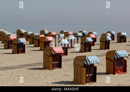 Beachchairs at the beach in Travemuende, Germany - Stock Photo