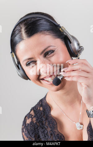 Cheerful customer service agent, telemarketing lady - Stock Photo