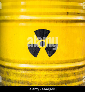 Radioactive sign, icon and symbol on yellow nuclear waste barrel. - Stock Photo