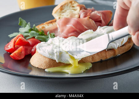 Benedict eggs on buttered wholemeal toast breakfast, - Stock Photo
