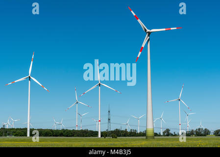 Wind energy plants on a sunny day seen in rural Germany - Stock Photo