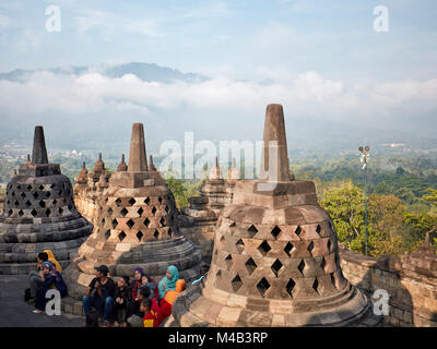 Tourists in Borobudur Buddhist Temple. Magelang Regency, Java, Indonesia. - Stock Photo