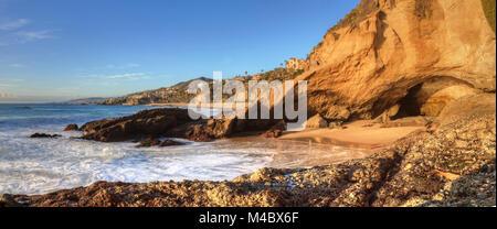 Blue sky over the coastline of One Thousand Steps Beach - Stock Photo