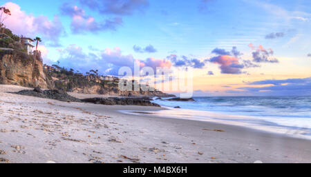 Sunset over the coastline of One Thousand Steps Beach - Stock Photo