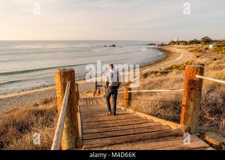 Man walking at boardwalk to beach, Malibu. - Stock Photo