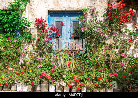 Flower covered house in Paleochora on Crete - Stock Photo