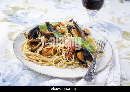 Spaghetti with blue Mussels on Plate - Stock Photo