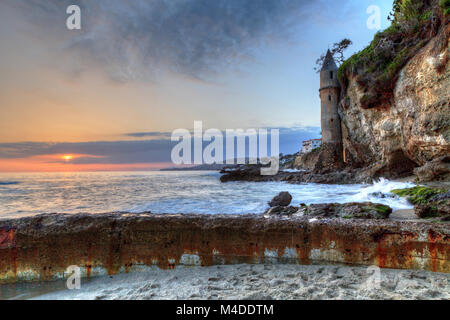 Sunset over Pirates tower at Victoria Beach in Laguna Beach - Stock Photo