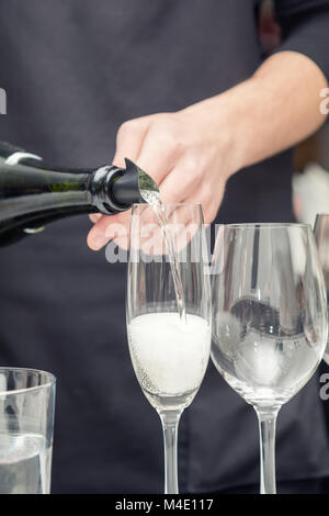 Sommelier pouring wine to the wine glass - Stock Photo