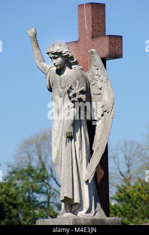 Angel statue on cross - Stock Photo