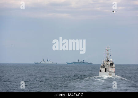BLACK SEA (Feb 05. 2018) Two Romanian Air Force MiG 21s, fly over NATO vessels (SNMG2 and SNMCMG2) during an Air - Stock Photo