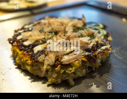 okonomiyaki on a plate - Stock Photo