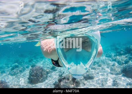 Woman snorkeling underwater in Indian Ocean, Maldives - Stock Photo